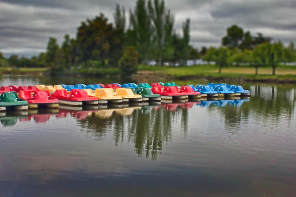 A COLORFUL LINE OF PADDLE BOAT'S