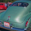 green Oldsmobile: Back view of the Oldsmobile