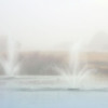 Twin fountains in the fog