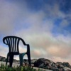 A lone chair  on the rock's